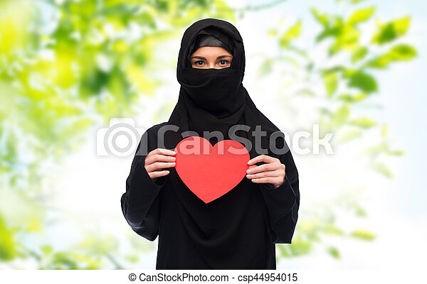 muslim woman in hijab holding red heart - csp44954015