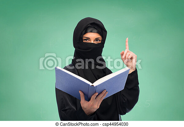 muslim woman in hijab with book over white - csp44954030