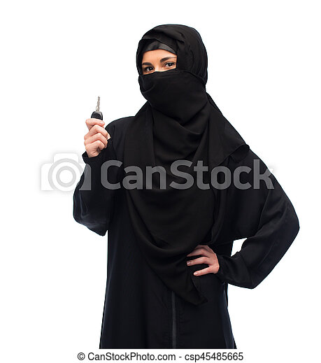 muslim woman in hijab with car key over white - csp45485665