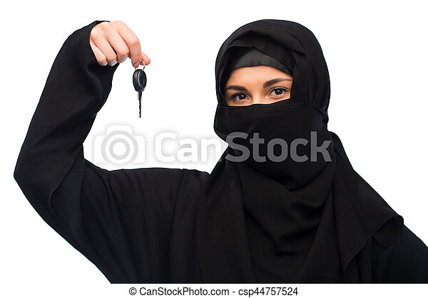 muslim woman in hijab with car key over white - csp44757524