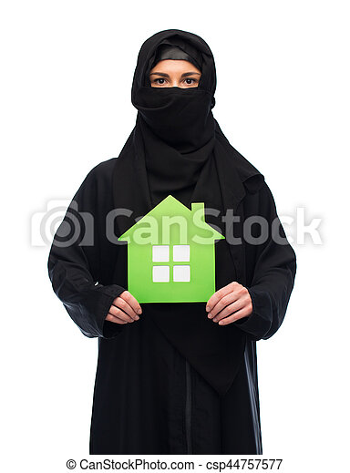 muslim woman in hijab with green house over white - csp44757577