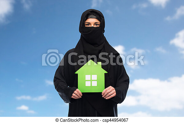 muslim woman in hijab with green house over white - csp44954067