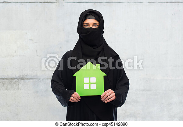 muslim woman in hijab with green house over white - csp45142890