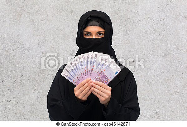 muslim woman in hijab with money over white - csp45142871