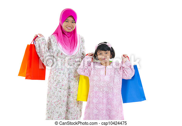 muslim women with shopping bags - csp10424475