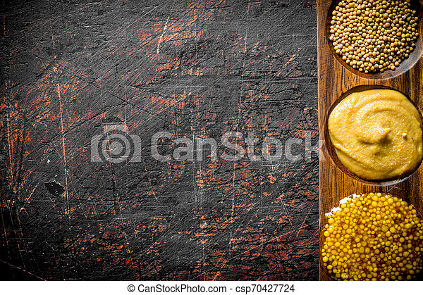 Mustard in a wooden stand. - csp70427724