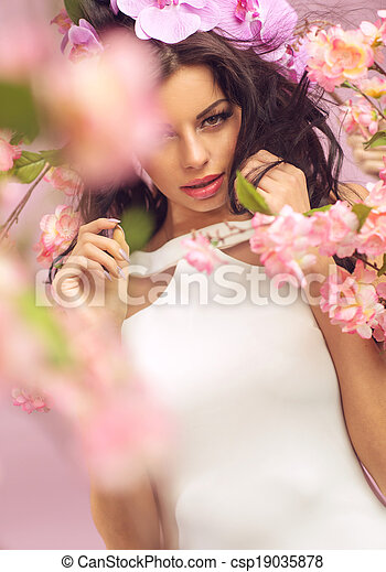 Mysterious brunette woman with lots of flowers - csp19035878