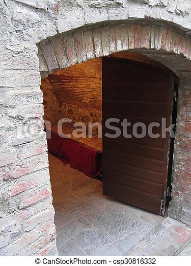 Mysterious door secret entrance with warm light inside - csp30816332 & Mysterious door secret entrance with warm light inside stock ...