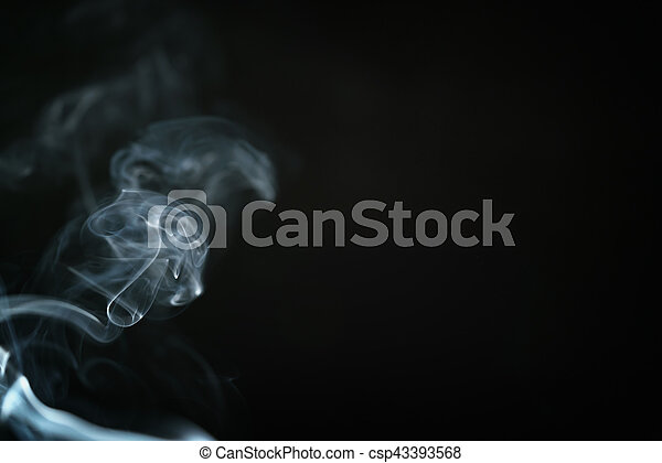 mystery blue smoke over dark background with copy space - csp43393568