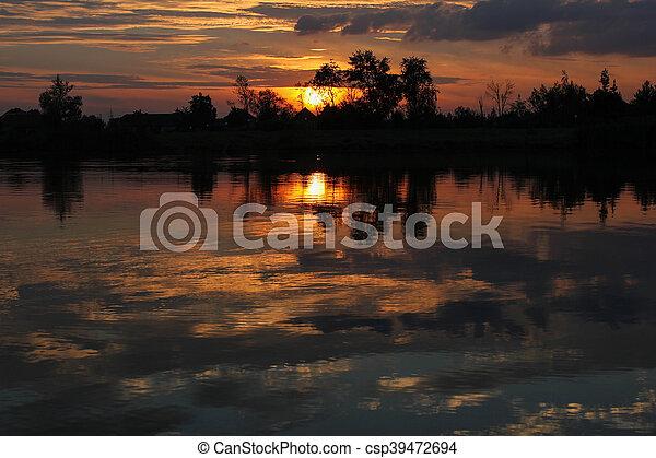 mystic summer sunset over lake - csp39472694