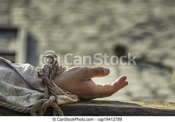 Nailed hand on wooden cross - csp19412789