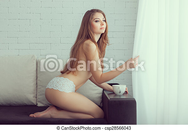 Naked Girl Opened Curtain On The Window And Looks Csp28566043
