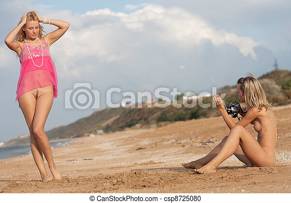 Naked girl sitting on beach All above