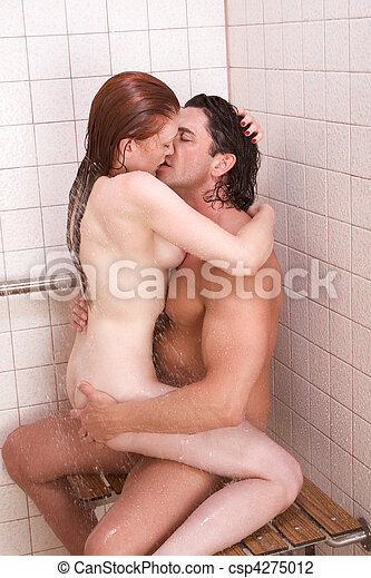 Naked men and women in a shower