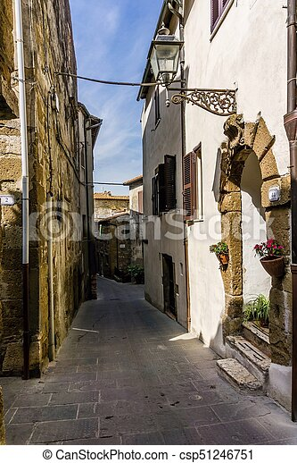 Narrow ancient street in the Pitigliano town in Tuscany Italy - csp51246751