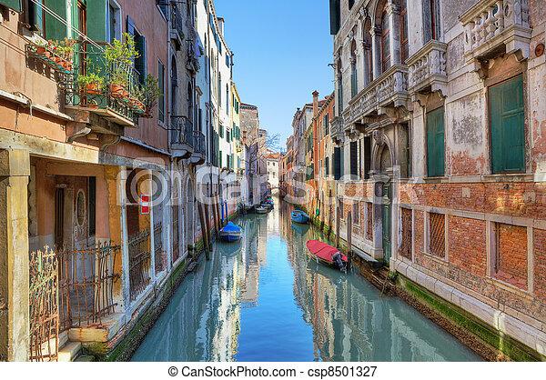 Narrow canal among ancient houses. Venice, Italy. - csp8501327