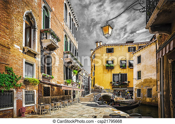 Narrow canal among old colorful brick houses in Venice - csp21795668