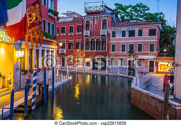 Narrow canal among old colorful brick houses in Venice - csp22615858