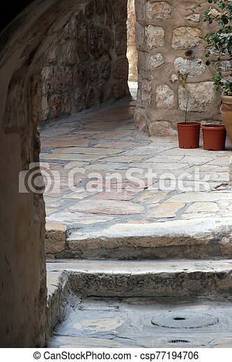 Narrow street in the Old City of Jerusalem - csp77194706