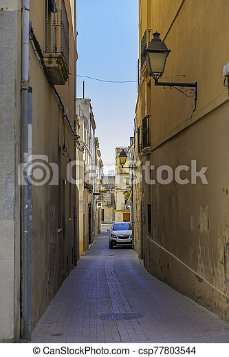 Narrow street in the village Arbos del Panades . The town is a located in the province of Tarragona. - csp77803544