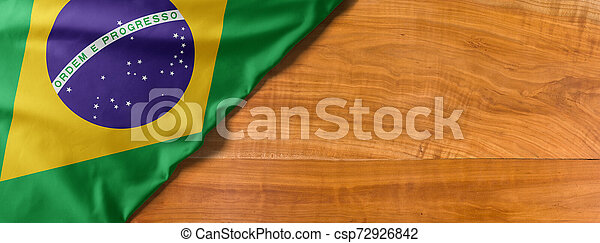 National flag of Brazil on a wooden background with copy space - csp72926842