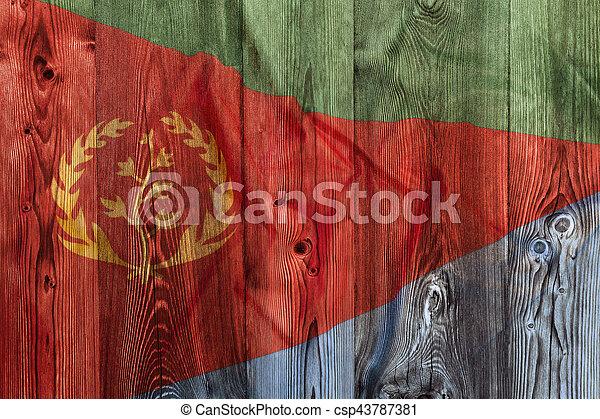 National flag of Eritrea, wooden background - csp43787381