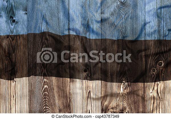 National flag of Estonia, wooden background - csp43787349