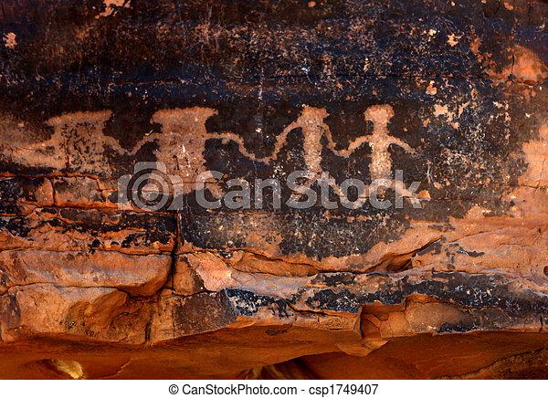 Native American Petroglyphs in Red Sandstone - csp1749407
