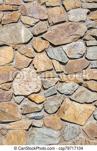natural brown and grey stone wall background - csp79717104