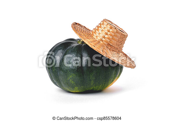 Natural green pumpkin, straw village hat, on a white background - csp85578604