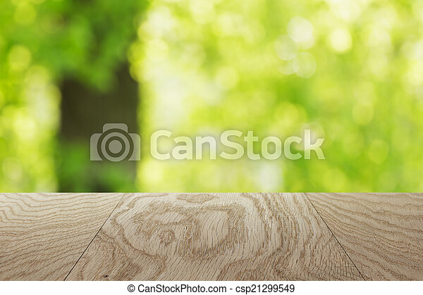natural oak table template with blurred oak tree on background - csp21299549
