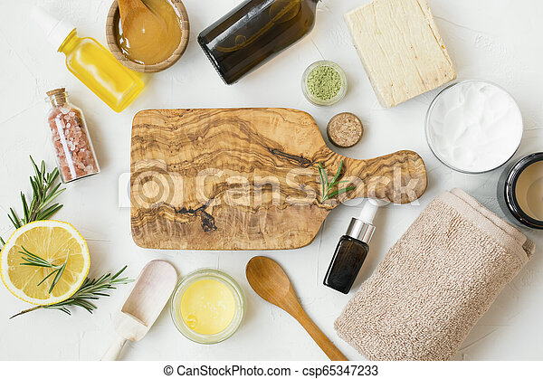 Natural organic skincare products with bath salt, oil, balm, lemon, honey for skin treatments, wooden board copy space - csp65347233