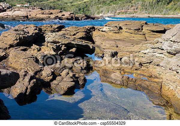 Natural rocky pool in Buzios - csp55504329