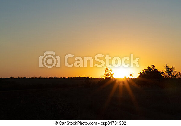 Natural sunset or sunrise over the field. Countryside - csp84701302