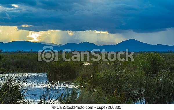 nature lake sunset over the mountain - csp47266305