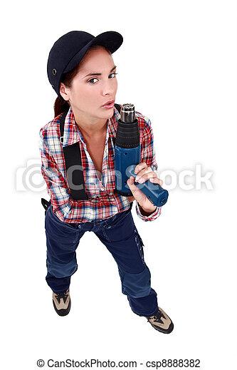 Naughty woman blowing on a screw gun - csp8888382