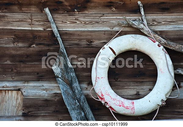 Nautical themed objects on wooden background - csp10111999