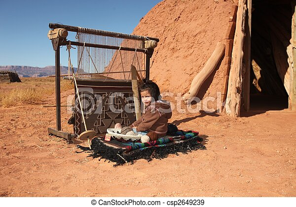Navajo Child Sitting Next to Traditional Rug Making Tools - csp2649239