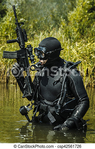 Navy seal frogman with complete diving gear and weapons in the water - Navy seal dive gear ...