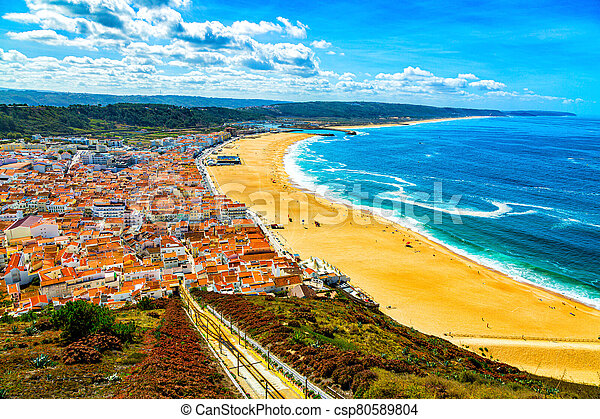 Nazare, Portugal: Panorama of the Nazare town and Atlantic Ocean seen from viewpoint on Nazare Sitio hill - csp80589804