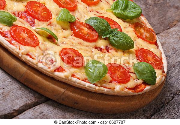 Neapolitan pizza margarita on the old wooden table - csp18627707