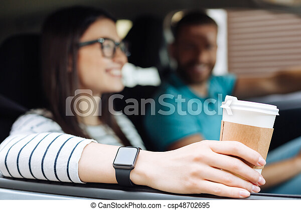 Neat female hands holding a cup of coffee - csp48702695