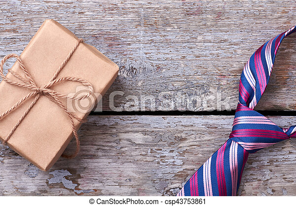 Necktie and wrapped present. - csp43753861