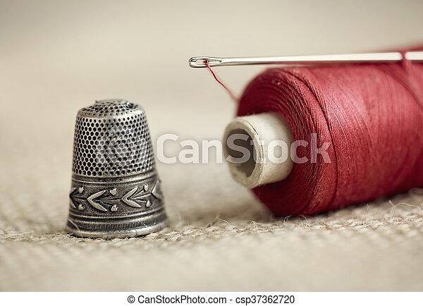 Needle, thread and thimble - csp37362720