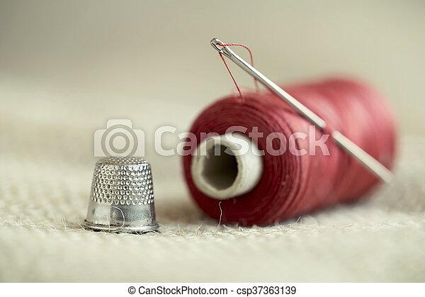 Needle, thread and thimble - csp37363139