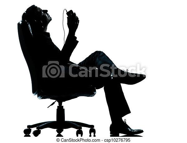 negócio, escutar, um homem, relaxamento, música, silueta - csp10276795