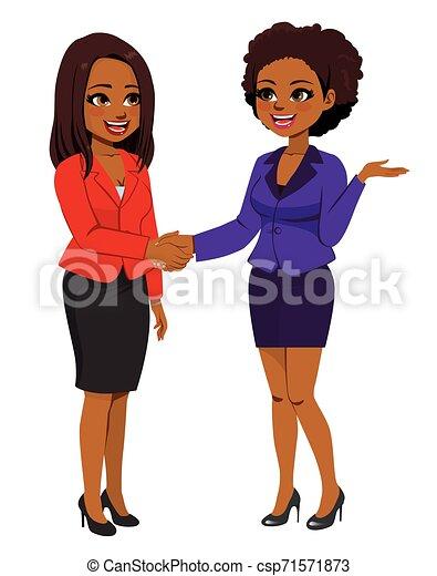 Mujeres de negocios negras estrechando la mano - csp71571873