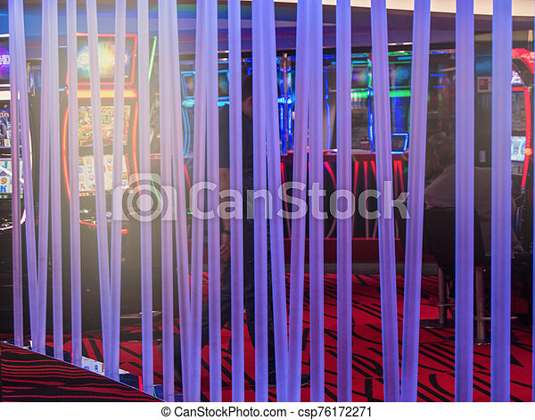 Neon glowing tubes in the interior of the casino, dark background - csp76172271