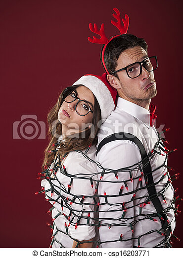 Nerd couple have problems with christmas decoration - csp16203771