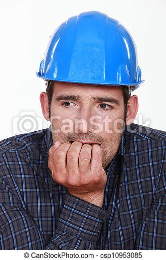 Nervous man wearing a hardhat - csp10953085